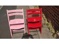 Stokke tripp trapp highchairs, £40 each or £70 the pair. One red chair and one pink chair