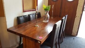 Beautiful solid wood large dinning table with 6 chairs for sale