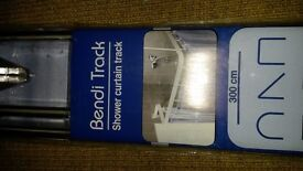Bendy shower curtain rail. BNIB. can deliver