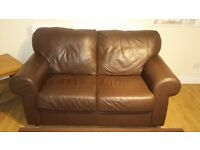 FREE. Brown leather 2 seater sofa. Good condition (no fire retardent labels). Collection only
