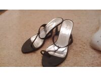 Black shoes with toe detail. Size 4.