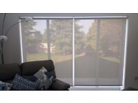 Magic screen roller blinds (2 available).