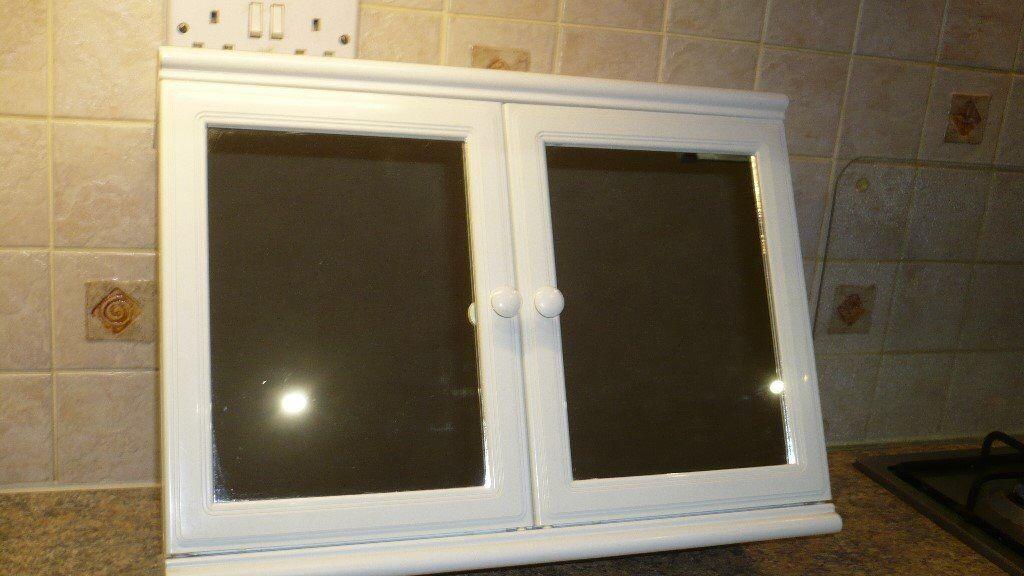 White plastic wallmounted bathroom cabinet