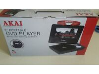 """7"""" portable dvd player (new)"""