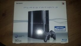 Boxed PS3 with all connection leads, x2 DUALSHOCK3 controllers and x1 bluetooth earpiece