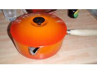 4 Le Creuset pots in Volcanic orange cast iron