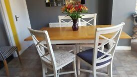 Table extends from 4ft.6 to 6ft with a temovable leaf, 4 heavy chairs, 2 grey and 2 script,