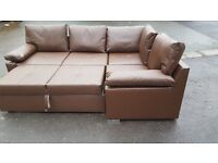 Comfy Brand New brown faux leather corner sofa bed with storage.small mark. can deliver