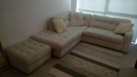 Large corner sofa with matching pouffe