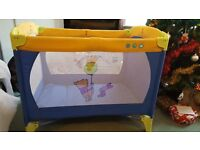 Travel cot for sale. Good clean condition. Winnie the pooh decal.
