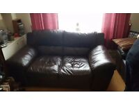 Brown 2 seater leather sofa for quick sale £50.00