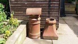 Two clay chimney pots: tall spherical one, and shorter square base with round top; and one cowl