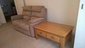 2 seater sofa and a solid oak coffee table