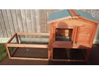 Rabbit hutch with outside weather protection