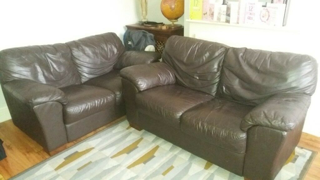 pair of dark brown leather sofas 2 seater