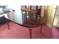 Extendable wooden table and 6 chairs