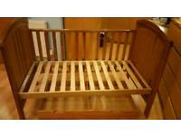 Mothercare solid wood cot bed. Good condition apart from drop-side damaged. BS30.