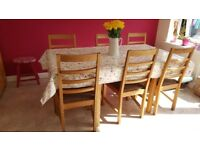 Oak and oak veneer dining table and chairs