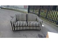Very modern black & white material sofa, this was £650 in creations we need £99!