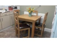 SOLID WOOD DINING TABLE WITH FOUR SOLID WOOD CHAIRS.