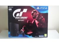 brand new Sony Play Station 4, with 12 months free play station live