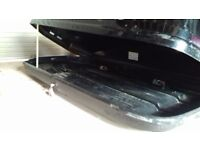 Exodus roof box. 6ft x 2ft6inch gloss black. One key. Has broken lid support on one side . Easy fit