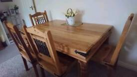 Fabulous solid wood table and four chairs