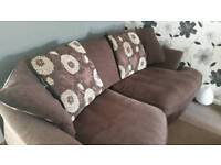 Brown sofa can turn floral cushions over so it's all brown