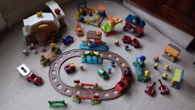 HappyLand village including train track and station, markets stools, farm, animals people, vehicles