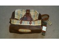 Burberry Weekender travel bag and suitable as flight bag in Burberry House check in Leather