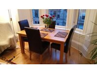 Large real wood dinning table and chairs