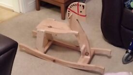 Wooden rocking horse suitable for 2 year old.