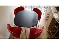 Hygena Amparo space saving dining table with 4 chairs. in good used condition. .