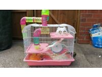 Used hamster cage with accessories, pink and white