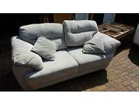 Two grey fabric sofas