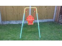 Child's swing from Smyths. 18 months +. 3 point safety harness with mesh sides. Great condition