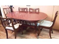 Large wooden table and 6 chairs