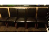 Brown wooden table and 5 faux leather brown chairs