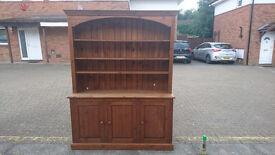 Real wood shelving unit with adjustable shelves and inbuilt power sockets.