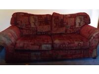 Very comfortable patterned maroon sofa
