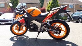 Honda CBR 125 cc Repsol Learner legal motorbike. Sport / Super / Eco / Orange