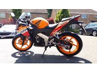 Honda CBR 125 cc Repsol Learner legal motorbike. Sport / Super / Eco / Orange