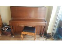 Lovely Brown Piano with nice tone