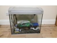 Complete fish tank with accessories: gravel, pump, lamp, background and many more, only £70