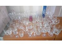SELECTION OF ODD GLASSES, FROM SMALL GLASSES TO TALL WINE GLASSES, BEER GLASSES