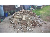 hardcore. broken up concrete slab and bricks. Free to collect. Can't deliver. I guess 1 to 1.5 tonne