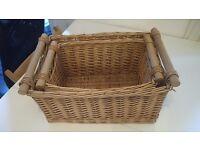Pair of nesting wicker baskets