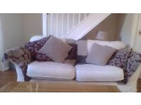 Cream three seater sofa/sofabed. Lovely comfy sofa with removable washable covers.