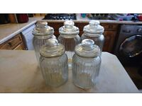 Set of 5 matching glass storage jars for sale, used to hold sweets at wedding.3 large 2 smaller. £15