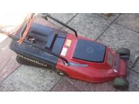 MOUNTFIELD LAWNMOWER WITH ATTACHED GRASS COLLECTOR